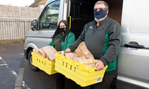 Morrisons workers deliver donated lunches to the centre
