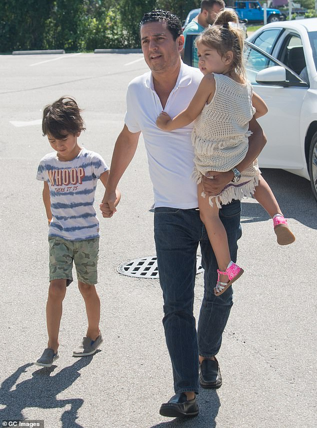 The kids: Michael is seen with their daughter Rio, now nine, and son Jagger, now 11, above back in 2016