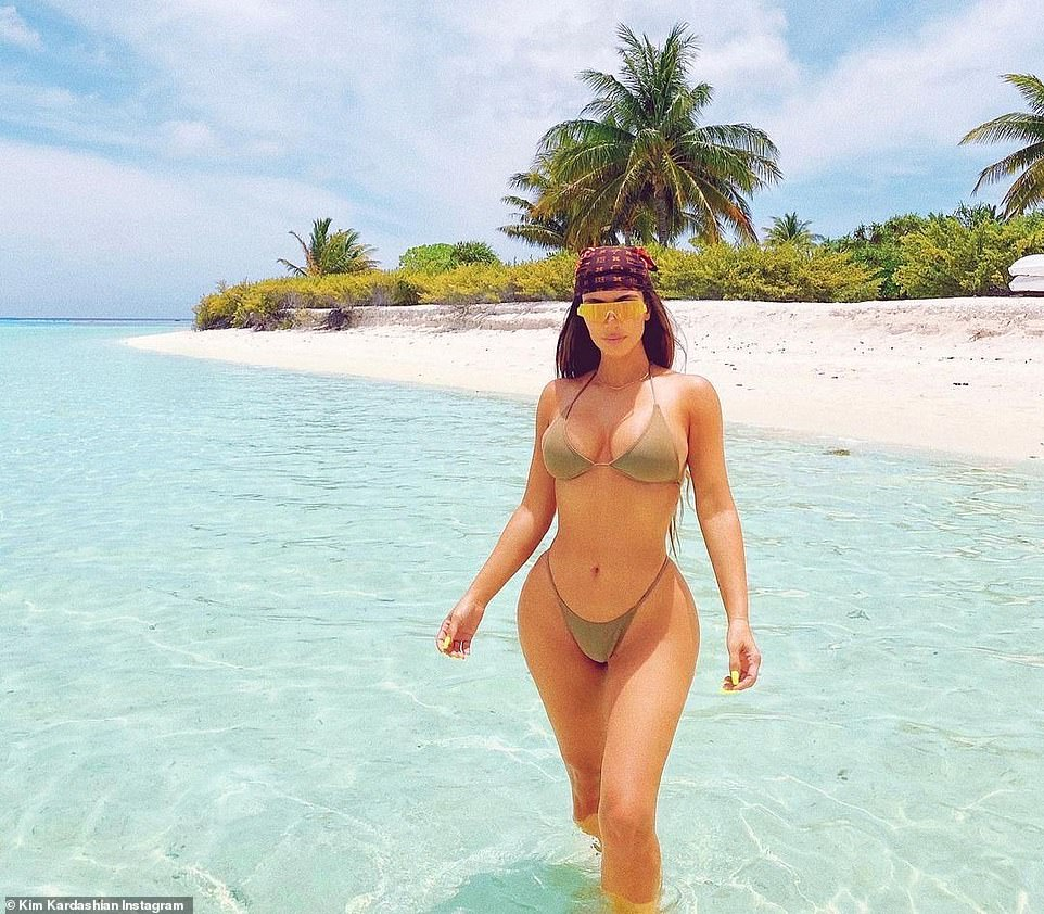 Heating up the tropics:On Monday morning the Keeping Up With The Kardashians star posted four images while in the ocean on a white sandy beach