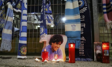 Candles and scarves lie next to a picture of legend Diego Maradona outside the San Paolo Stadium in Naples.