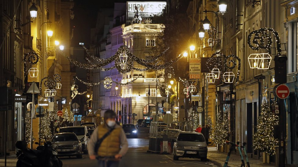 Rue Saint-Honore is decorated with illuminations for Christmas and New Year celebrations on November 22, 2020 in Paris