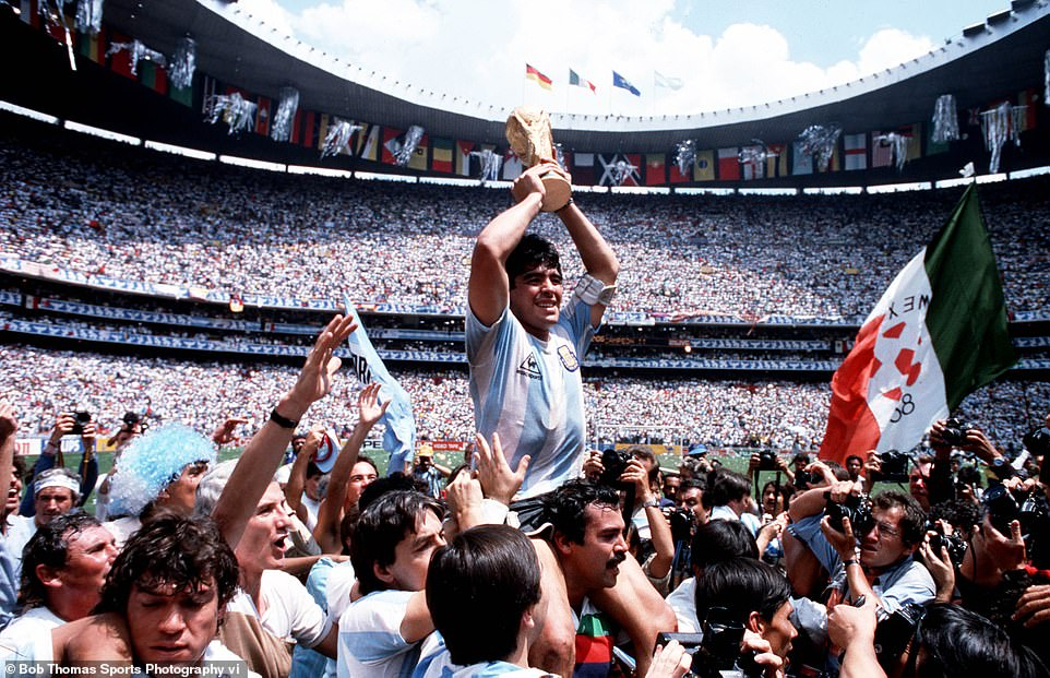 Maradona's finest hour: Lifting the World Cup after inspiring Argentina to victory in the 1986 tournament which included his infamous 'Hand of God' goal in the quarter-final against England