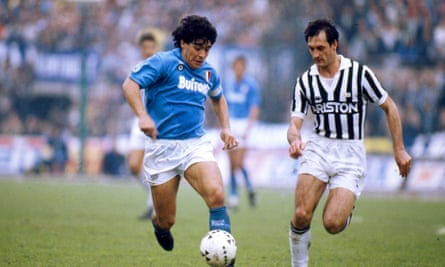 Maradona goes up against Juventus's Luigi De Agostini during his time at Napoli. The Argentinian led the club to two Serie A titles as well as the Uefa Cup.