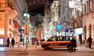 Armed policemen stand guard in a shopping street in the centre of Vienna