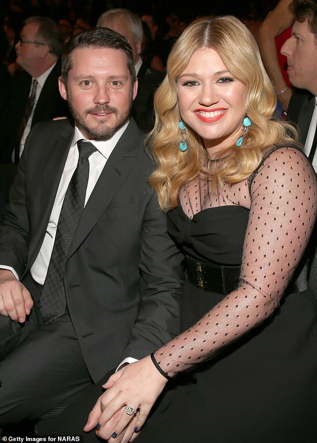 'People, like, could be bad for you in a certain time': Kelly Clarkson appeared to hint at a possible reason behind her split from Brandon Blackstock on her talk show (pictured 2013)