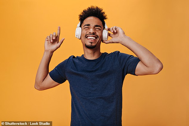 Researchers from France found that listening to the music you love (as pictured) does indeed give you chills — and sends your brain into 'pleasure overload', they said