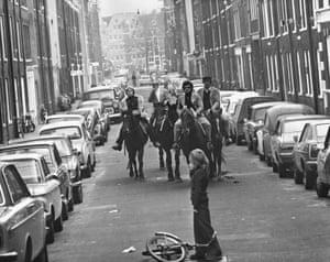 Four horsemen riding through the streets of Amsterdam, 4 November 1973.