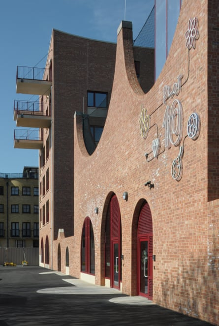 A street view of Plot 10, its 'bouncing' brick arches and the adjacent block of 10 flats.