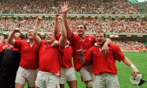 Garin Jenkins (second left), seen here in 1999 at the first international to be played at the Millennium Stadium in Cardiff.