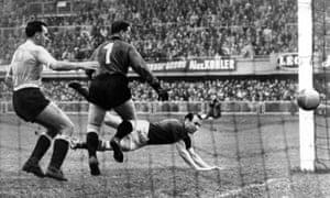 Hungary's Nandor Hidegkuti dives at full length to score their second goal.