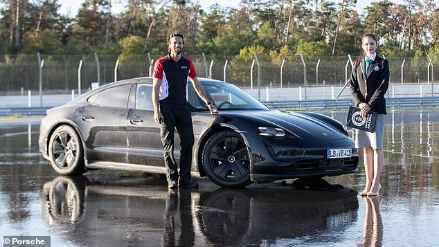 Picture (left) is Dennis Retara who drove Porsche into the Guinness World Records and right is Guinness World Records official record judge Joanne Brent who supervised the attempt