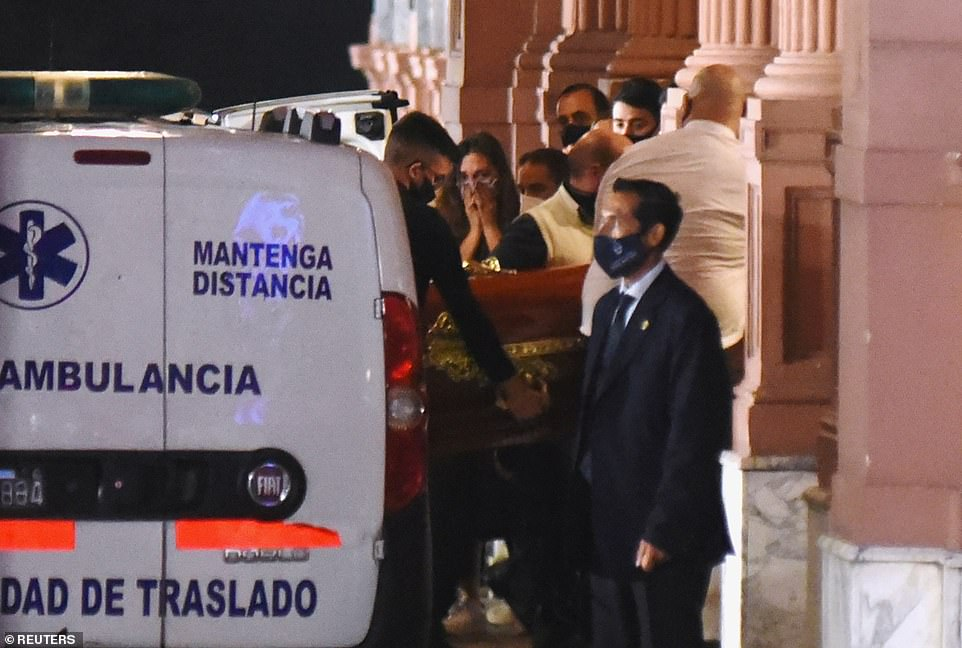 Diego Maradona's coffin is lifted out of an ambulance and taken into the Casa Rosada presidential palace in Buenos Aires in the early hours of this morning after the football legend died on Wednesday at the age of 60