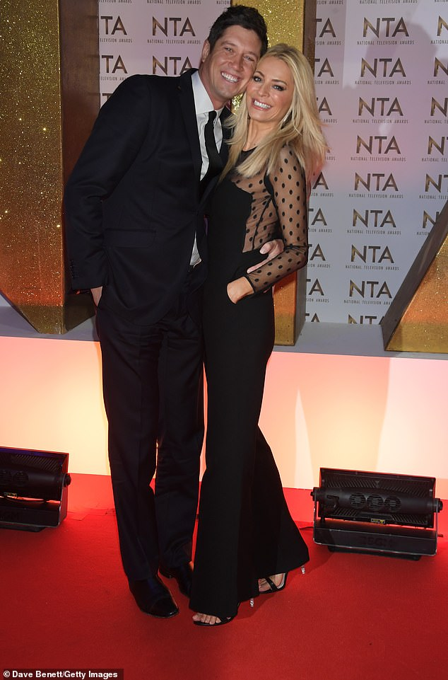 Still together:Vernon was famously forced to make a public apology to his wife Tess Daly, 51, (pictured in January 2020) on BBC Radio in 2010 after their saucy messages came to light