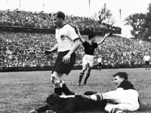 Ferenc Puskás slides in to score, only to see his equaliser disallowed.