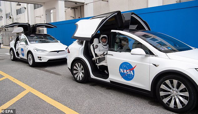 Donning the same white, futuristic SpaceX suites, Crew-1 commander Michael Hopkins, Victor Glover, Shannon Walker and Japanese astronaut Soichi Noguchi arrived at the complex in two Tesla Model X cars during a dress rehearsal on Thursday