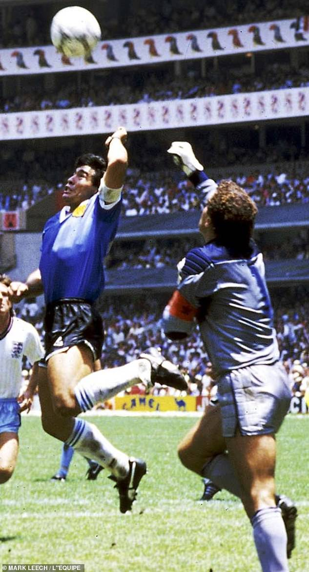 Maradona opens the scoring for Argentina, palming the ball over England keeper Peter Shilton in the famous 'Hand Of God' incident in 1986