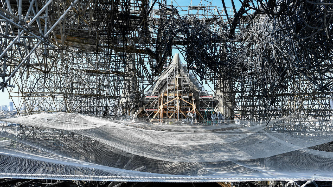 Parts of a destroyed ribbed vault and the mangled scaffolding are seen during preliminary work on Notre Dame on July 17, 2019, three months after the fire.