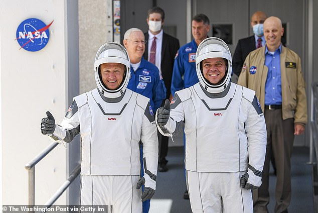The astronauts, named Crew-1, took the walk through Kennedy Space Center as did Ben Behnken (right) and Dough Hurley (left) in May when they prepared for 'Launch America' that brought space flight back to US soil.