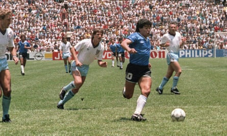 Maradona runs past Terry Butcher, left, and Terry Fenwick, second left, on his way to scoring his second goal against England in 1986. It is regarded as being one of the greatest goals of all time