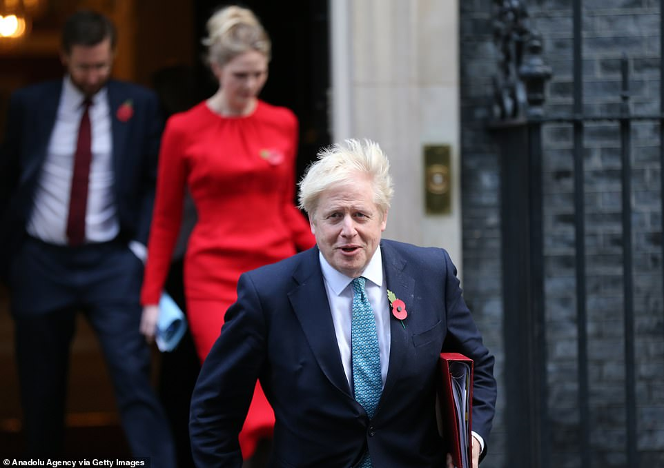 Boris Johnson is pictured leaving 10 Downing Street where he attended a cabinet meeting this morning. He reportedly insisted the lockdown restrictions would come to an end on December 2