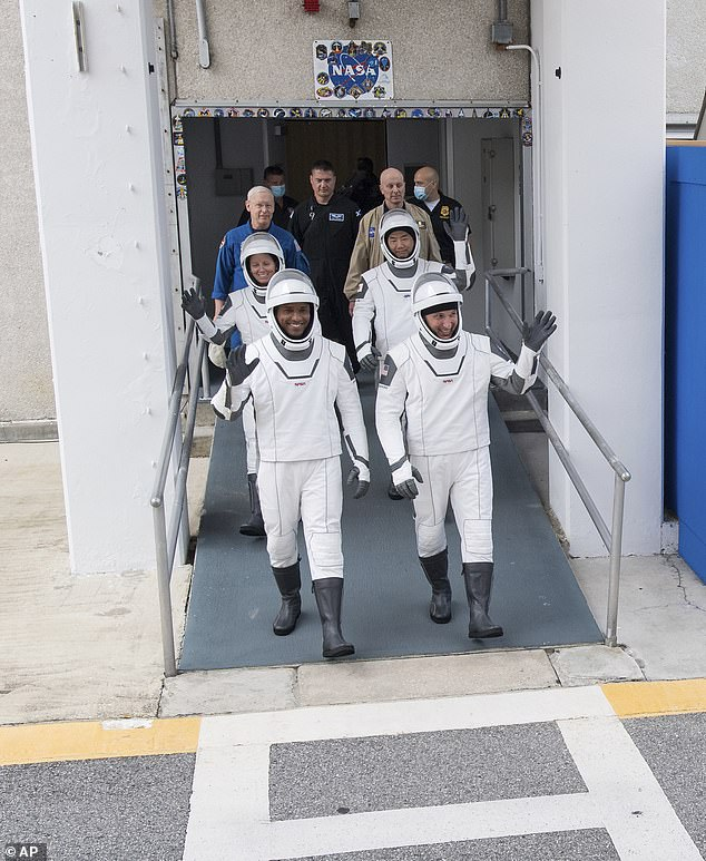 Pictured isCrew-1 commander Michael Hopkins (right, front row), Victor Glover (left, front row), Shannon Walker (left, back row) and Japanese astronaut Soichi Noguchi (right, back row)