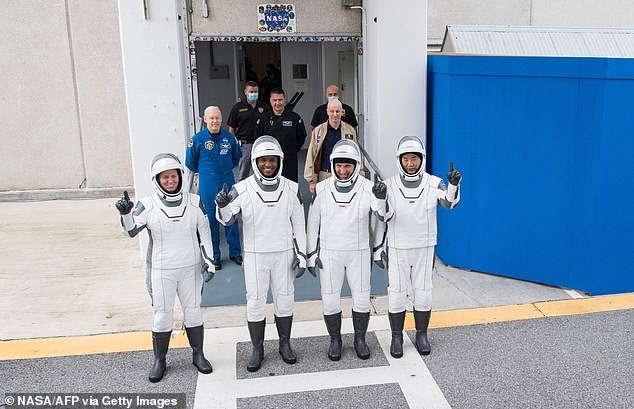 The team emerged from the crew quarters, smiled and waved, and then climbed back in the Teksa's for the 20-minute ride to Launch Complex 39A