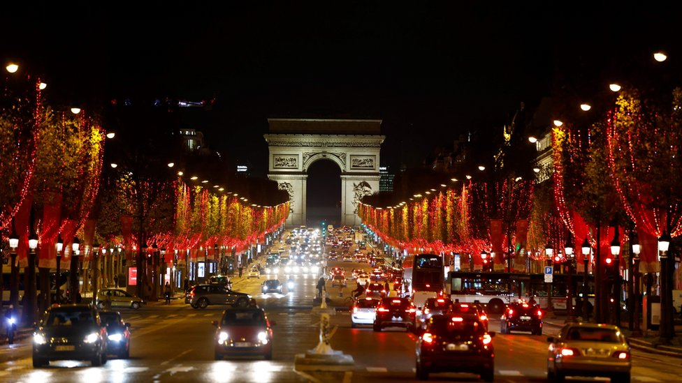 A picture taken on November 23, 2020 shows the Champs Elysees avenue illuminated