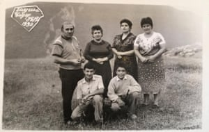 A black-and-white photo of Hagigat Hajiyeva (top row, second from left) and four other members of her family from 1990