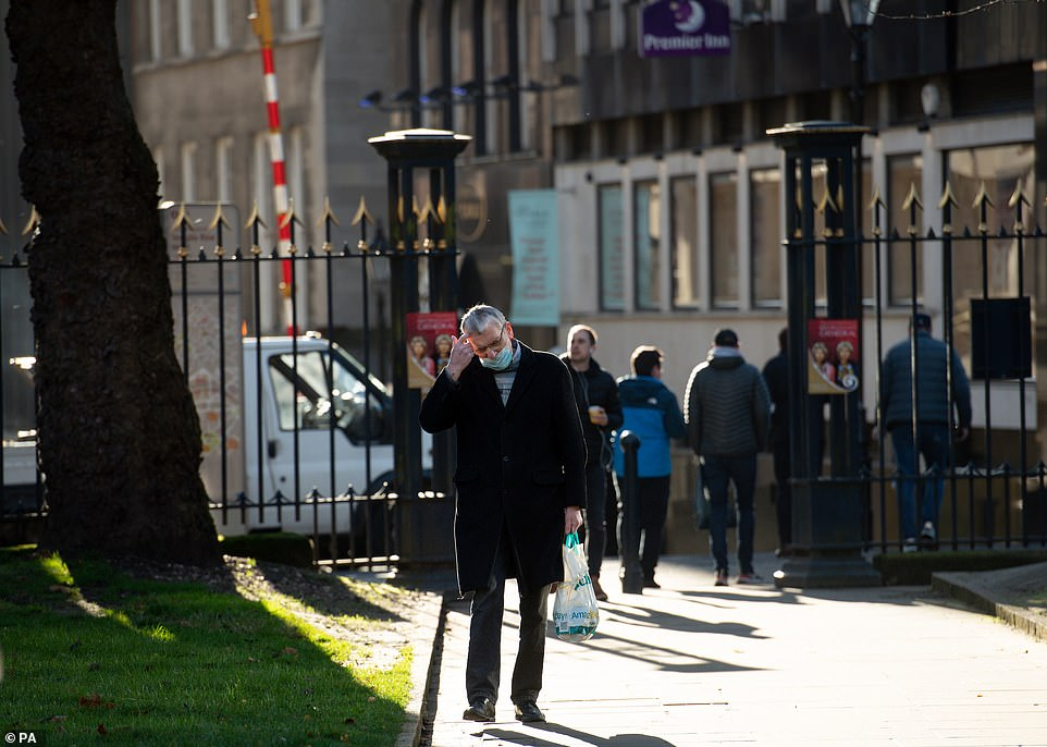 People walk through Birmingham today, before the region goes into tier three rules next week