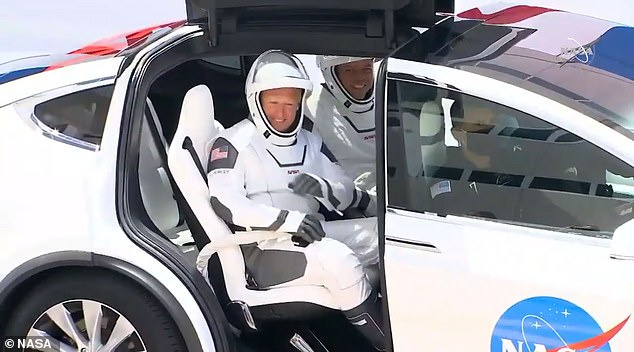 Bob Benhken (back) and Doug Hurley (front) rode to Kennedy Space Center in May in the same Tesla Model X as the Crew-1 team