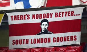 A banner supporting Mikel Arteta hangs at the Emirates during the Carabao Cup quarter-final capitulation to Manchester City.