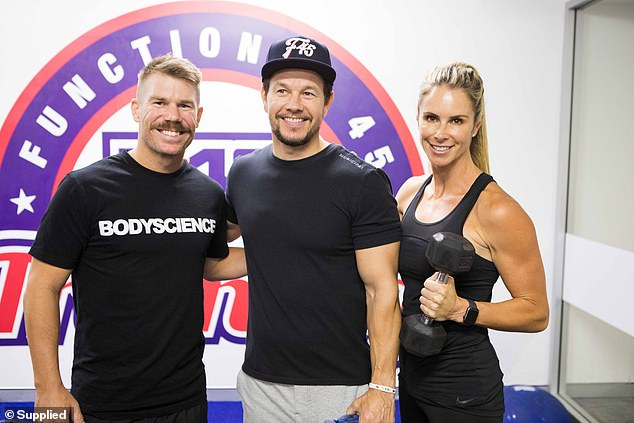 A-list fitness: Mark also led an intense workout at an F45 gym in Sydney's Woolloomooloo on December 15 while in Australia. Some of Australia's biggest celebrities were in attendance, including David and Candice Warner (pictured)