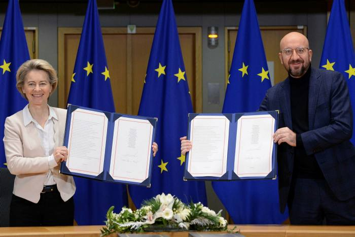 European Commission president Ursula von der Leyen and European Council president Charles Michel show off the new Brexit trade treaty after signing it in Brussels on Wednesday