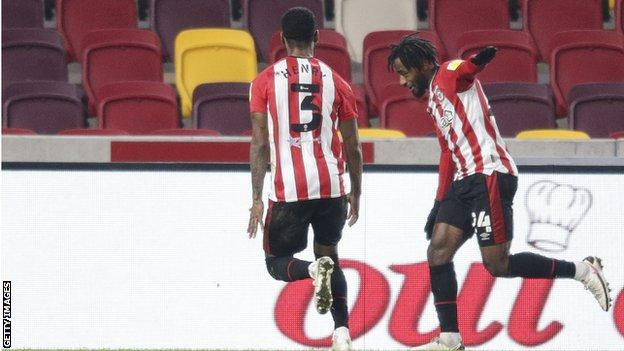 Tariqe Fosu celebrates his winner against Bournemouth