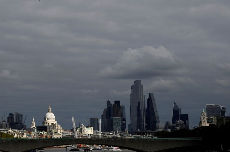 © Reuters. FILE PHOTO: St Paul's Cathedral is seen together with skyscrapers in the City of London financial district