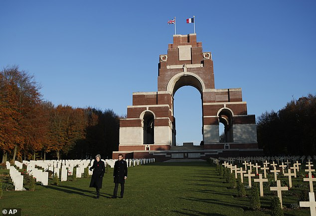 British war graves staff working in France and Belgium are reportedly facing a 50% pay cut due to Brexit. Pictured: Former British PM Theresa May (left) and French President Emmanuel Macron at the Thiepval Memorial in France, which commemorates servicemen who died in the Battles of the Somme