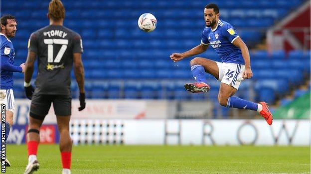 Curtis Nelson of Cardiff City plays the ball forward