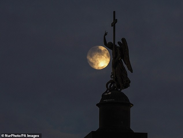 The 'Cold Moon' will rise out of the northeastern sky at 4:19pm ET (9:19pm GMT), with peak illumination at 10:30pm ET (3:30am GMT) Tuesday evening. Pictured is the full moon in St. Petersburg, Russia