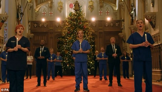 The Lewisham and Greenwich NHS choir could easily have been forgiven for thinking they had already reached the height of fame with their celebrity collaborations. They are pictured performing for the Queen's Christmas Day broadcast