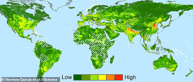 The sinking of the ground's surface — or 'subsidence' — will threaten nearly a fifth of the world's population come the year 2040, a study has warned. Pictured, the researchers map showing the risk of subsidence across the globe in 20 year's time. The white hatched areas represent regions where precise information on current groundwater levels is not available