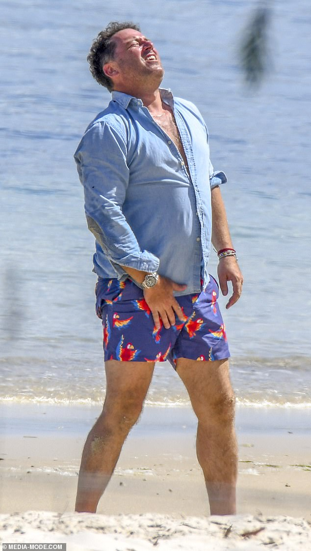 Below the belt:Karl Stefanovic, 46, writhed in pain after being hit in the groin by a cricket ball during a family beach outing in Noosa earlier this month