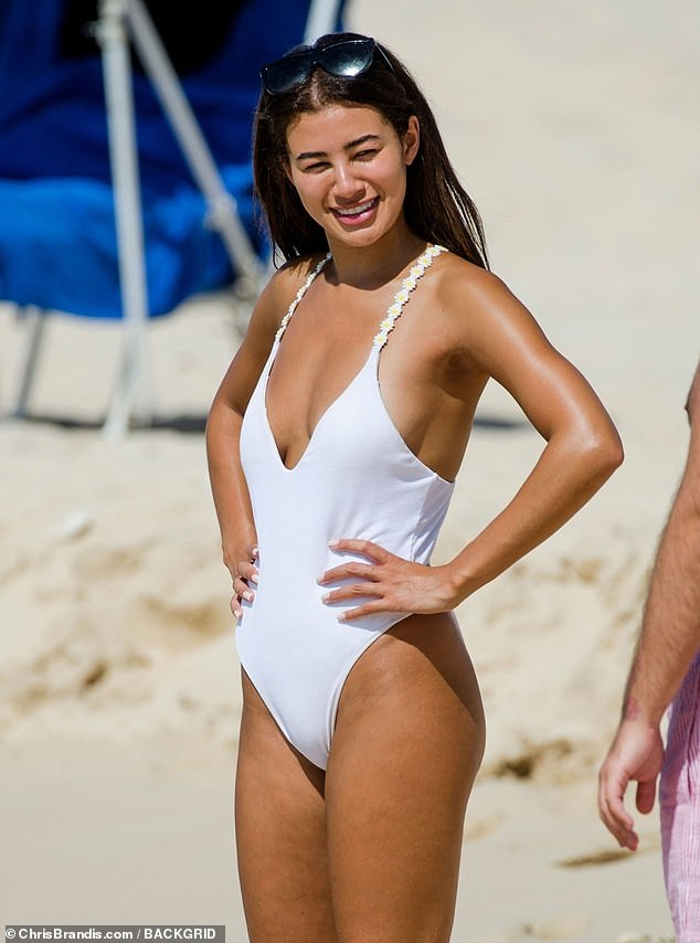 All white?Montana Brown was sure to show off both the stunning designs from her Swimwear Society range and her taut figure as she hit the shores on Wednesday