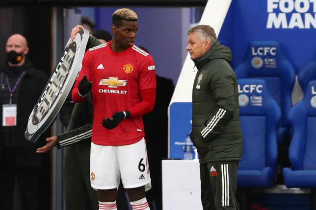 Ole Gunnar Solskjaer manager of Manchester United speaks with Paul Pogba during the Premier League match between Leicester City and Manchester United at The King Power Stadium on December 26, 2020 in Leicester, United Kingdom. The match will be played without fans, behind closed doors as a Covid-19 precaution.