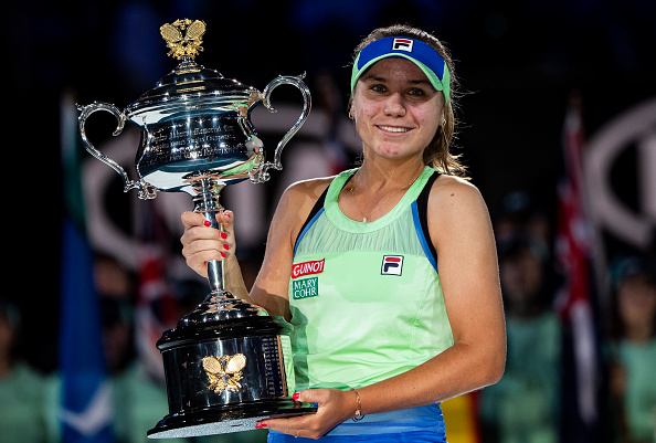 Sofia Kenin of the United States celebrates with the trophy after winning the women's singles final match against Garbine Muguruza of Spain on day thirteen of the 2020 Australian Open at Melbourne Park on February 01, 2020 in Melbourne, Australia.
