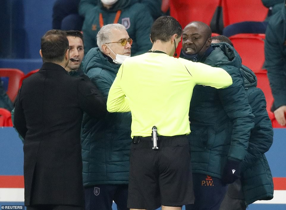 Pierre Webo (right), Basaksehir's assistant manager, was livid when he was allegedly identified as 'the black one over there' by the fourth official