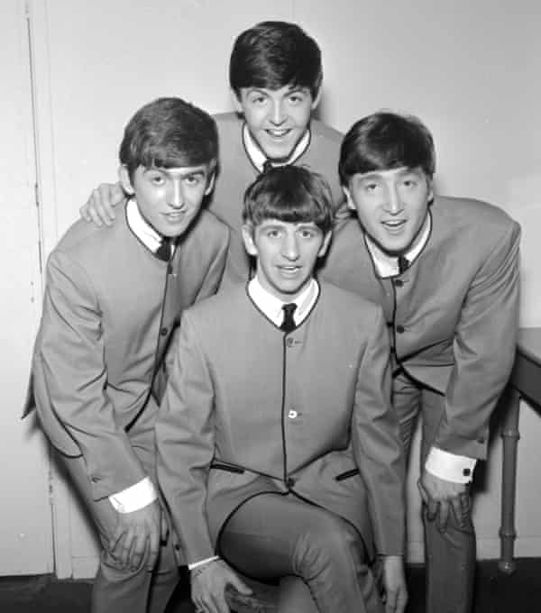 The Beatles pose in Pierre Cardin collarless jackets in 1963. (Clockwise from left) George Harrison, Paul McCartney, John Lennon, Ringo Starr.