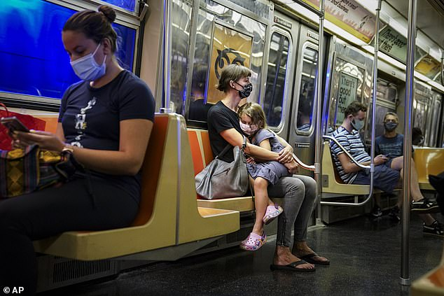 Researchers at NYU looked at transportation ridership and influenza/pneumonia mortality rates in 121 cities between 2006 and 2015. Pictured: Passengers ride the New York City subway, August 2020