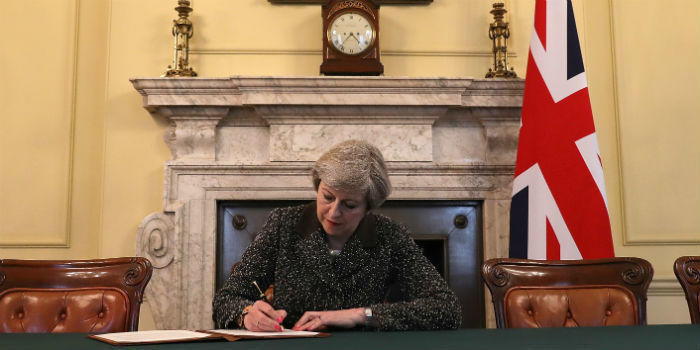 Theresa May signs the letter officially invoking Article 50.