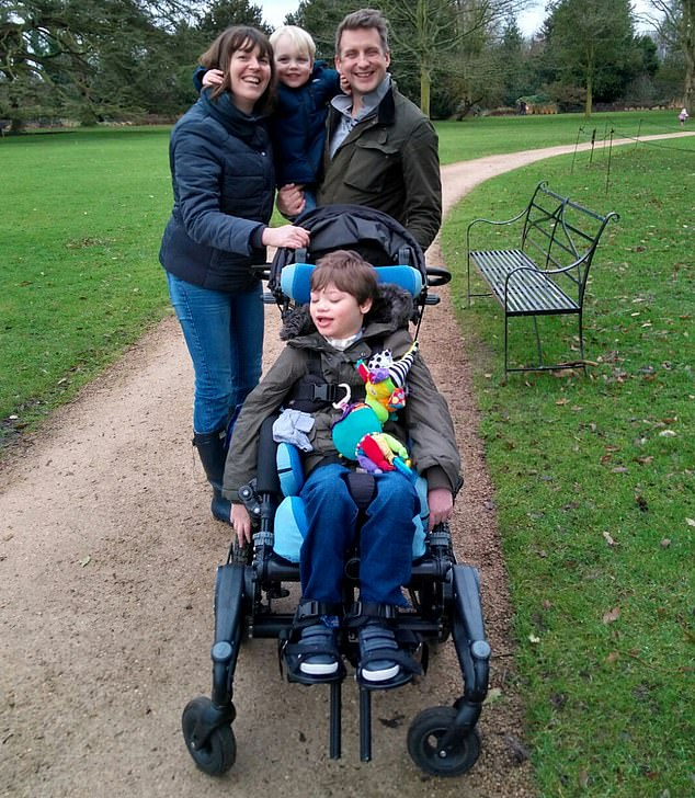 Josh Jones, from Warrington, suffers from a genetic illness and is severely disabled, requiring round-the-clock care which is provided by medical staff at the residential school where he stays five nights a week. Pictured: Josh with his parents Kate and Clive and brother Seb