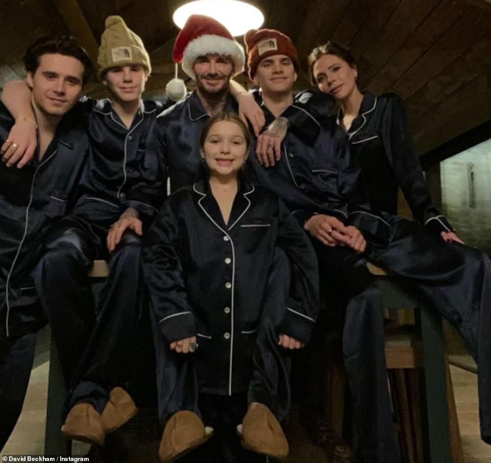 Family: David and Victoria Beckham and their four children, Brooklyn, 21, Romeo, 18, Cruz, 15, and Harper, nine, were among the stars giving their followers an insight into their cosy family Christmas